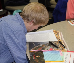 A high school student studies global health materials, including the stories of four girls named Anna who live in significantly different economic circumstances around the world. Students learned how a problem can have radically different outcomes, depending on access to care.