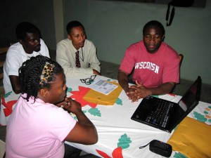 UW-Madison researcher Gergens Polynice, right, and his research assistants interviewed about 800 mango farmers to determine how to encourage families to plant more trees.
