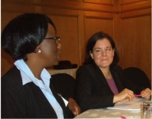 Lori DiPrete Brown confers with Zambian leader Anne Mumbi at a QI planning workshop.