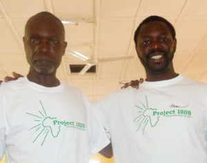 UW-Madison's Alhaji Njai with his former high school teacher who has become a mentor for students Project 1808 helps with school costs.