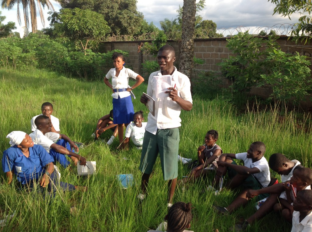 Students in northern Sierra Leone learn about hygiene and the signs of Ebola infection during a global health field course in spring 2014.