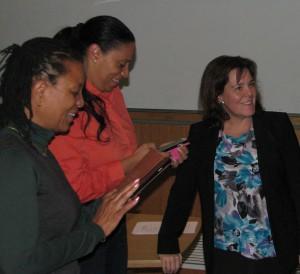From left, QI participants XXXXXXXX and XXXXXXX visit with QI Director Lori DiPrete Brown.