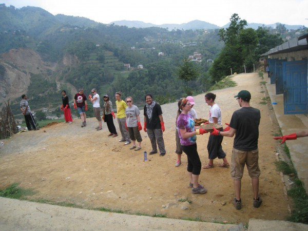 Students work in Nepal to help build a new path, as part of their field experience with Sweta Shrestha.