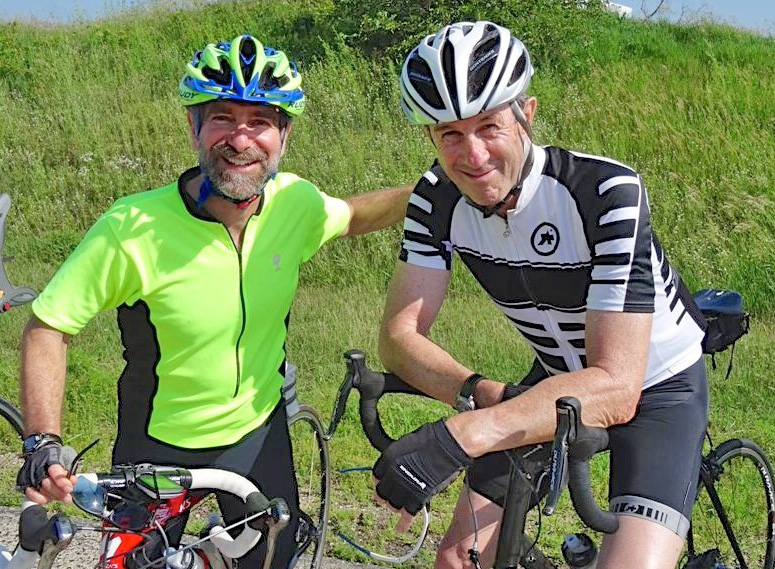 Bicycling is one of the loves entrepreneur John Holton, right, and GHI Director Jonathan Patz share.