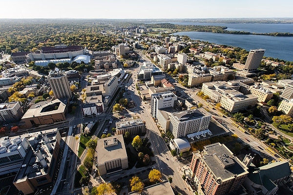 The central University of Wisconsin-Madison campus is pictured in an aerial view during autumn on Oct. 12, 2013. Clockwise from the bottom center, major campus facilities include the Chemistry Building, Noland Zoology Building, Charter Street Heating and Cooling Plant, Weeks Hall for Geological Sciences, Atmospheric, Oceanic and Space Science Building, Computer Sciences and Statistics, Wisconsin Institutes for Discovery (WID), Medical Sciences Center and Chamberlin Hall. In the background from left to right are Camp Randall Stadium, Lake Mendota and Picnic Point. The photograph was made from a helicopter looking west. (Photo by Jeff Miller/UW-Madison)