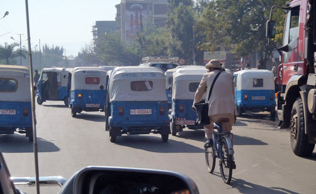 Three-wheeled bajajs clog roads in Bahir Dar, Ethiopia, leaving no room for safe bicycling.