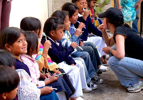 UW student working with children on dental hygiene