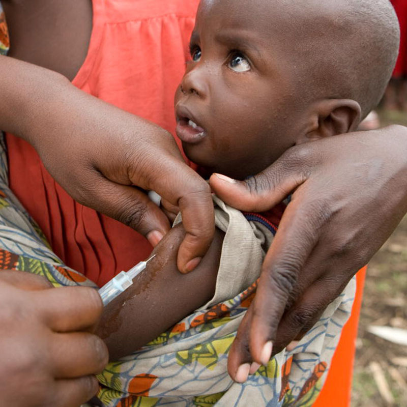 Young African child recieving immunization