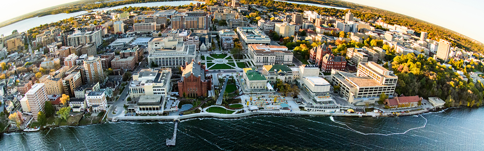 An aerial view of campus with Lake Mendota in the foreground