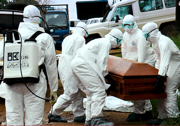Workers in HazMat suits carry the coffin of an Ebola victim.