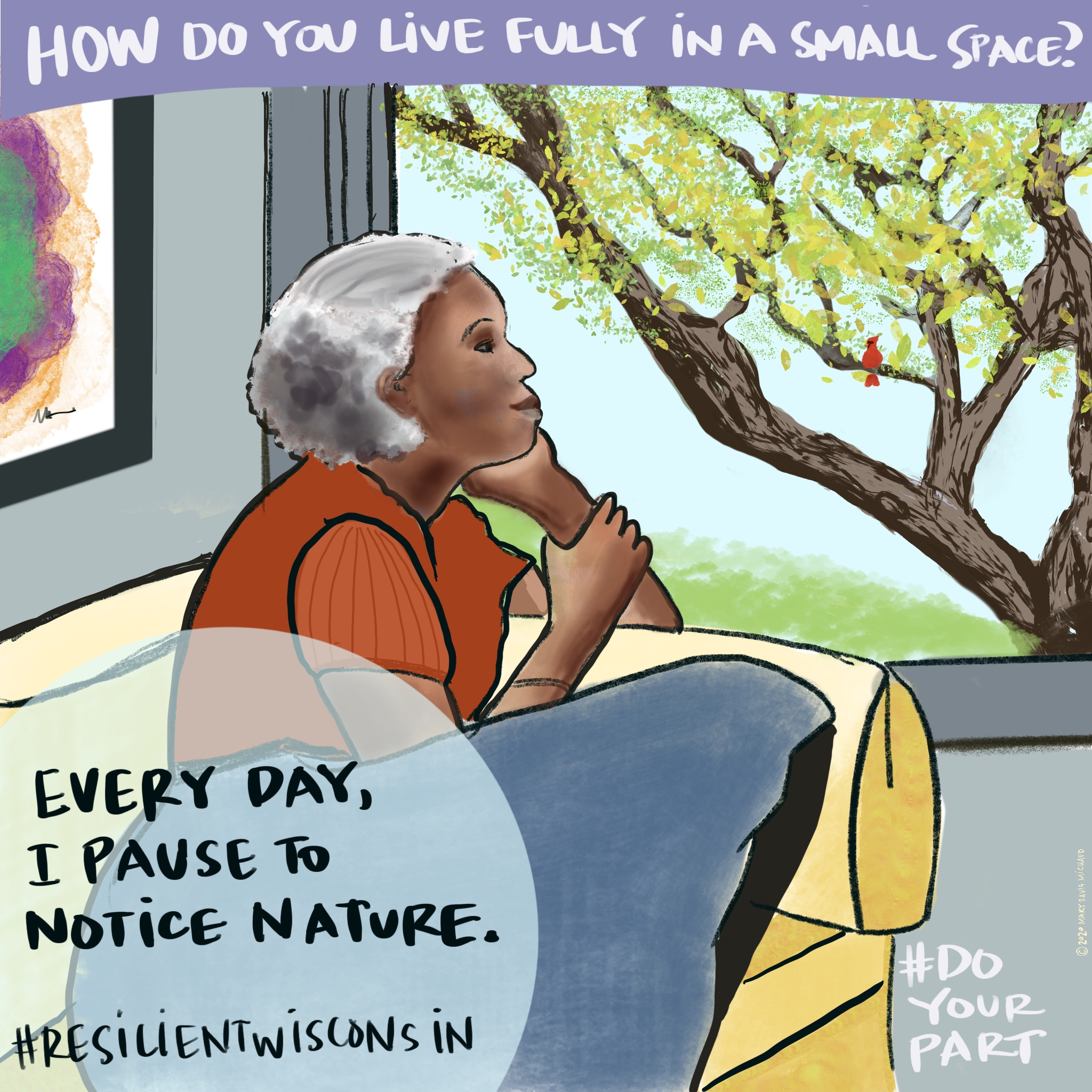 An older woman curls up on her couch and looks outside at a tree and cardinal.